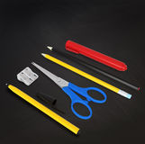 Set of school or office desk items on black board Stock Image