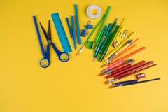 Set of school office supplies on orange background stock photo