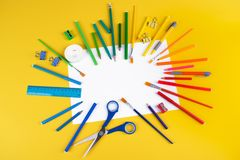 Set of school office supplies on yellow background royalty free stock photo