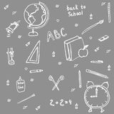 Set of school supplies. Drawn in chalk on blackboard Royalty Free Stock Photography