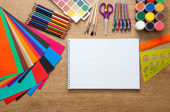 Set of school supplies. With pencil, colored pen, watercolor paint, notebook and scissors Stock Photography