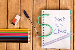 Set of school supplies on wooden background . Back to school stock photos