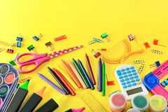 Set of school supplies on yellow background. Pencils, markers, p Royalty Free Stock Image