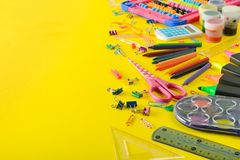 Set school supplies on yellow background. Top view. stock photos