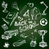 Set of school symbols on chalkboard Stock Photos