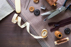 Set. Scissor, buttons, zip, tape measure, thread and thimble on Royalty Free Stock Images