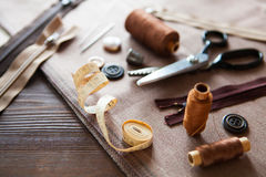 Set. Scissor, buttons, zip, tape measure, thread and thimble on Royalty Free Stock Photo