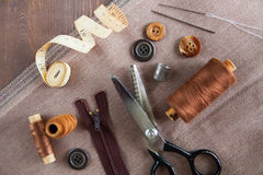 Set. Scissor, buttons, zip, tape measure, thread and thimble on Royalty Free Stock Image