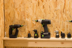 Set of screwdrivers adapters bits nozzles on wooden shelf. And background Stock Images