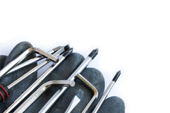 Set of screwdrivers and glove Royalty Free Stock Photo