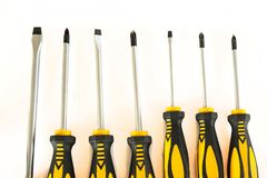 Set of screwdrivers. With rubber black and yellow handles isolated on a white background royalty free stock photos