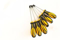 Set of screwdrivers. With rubber black and yellow handles isolated on a white background stock photo