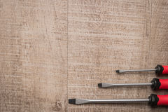 Set of screwdrivers. Tools over a wood panel. Top view with copy Stock Photo