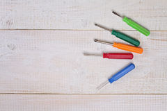 Set of screwdrivers on white wooden rustic background .Housework, tools, DIY concept Stock Photos