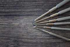 Set of screwdrivers on the wood table Royalty Free Stock Photos