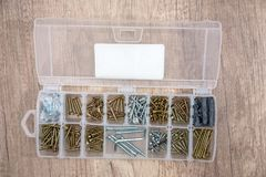Set screws in the box. On the table Stock Images