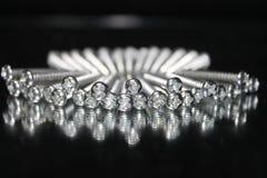 Set of screws under white light stock image