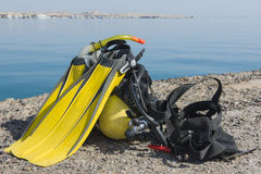 Set of scuba diving equipment by the sea Stock Photography