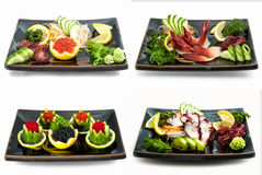 Set of sea food on black plate Royalty Free Stock Images