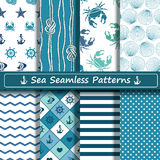 Set of sea seamless patterns. Set of blue and white sea seamless patterns. Scrapbook design elements. All patterns are included in swatch menu Royalty Free Stock Photo