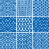 Set of  seamless backgrounds from fish scales in blue and white. A collection of designs of infinite patterns with an oval, semicircular, angular, triangular Royalty Free Stock Photography