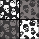 Set of seamless backgrounds with skulls Royalty Free Stock Photo