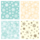 Set of seamless backgrounds with snowflakes Stock Photography