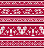 Set of seamless borders in the eastern style of painting. Ornament of white flowers and curls on a red background. Stock Image