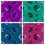A set of seamless fabric textured floral patterns against matching solid color backgrounds Stock Images