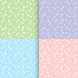 Set of seamless floral patterns. Light green, blue, violet and pink. Can be used for baby clothing and textile Royalty Free Stock Images