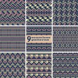Set of seamless geometric patterns dark blue, yellow, pink color. Set of seamless abstract geometric patterns. Fashion vector backgrounds collection dark blue Royalty Free Illustration