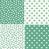 Set of seamless green shamrock leaf patterns Royalty Free Stock Photos