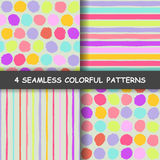Set of  seamless hand drawn graphic patterns. Made in vector. Set of four colorful seamless hand drawn graphic patterns with dotted and stripes. Polka dotted Stock Photography