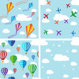 Set of seamless pattern on blue sky. Set of seamless pattern. Vector background with colorful jets, air balloons and kites on the blue sky Royalty Free Stock Image