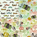 Set of 4 seamless pattern with a mustache camera bike.  Royalty Free Stock Photos