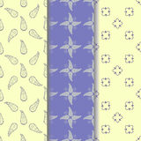 Set seamless pattern of yellow-beige ornament on a pastel blue and light yellow background Royalty Free Stock Photos