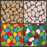 Set seamless patterns of abstract stones. Set of four seamless abstract wall pattern Royalty Free Stock Images