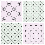 Set of seamless patterns with Fleurs-de-lis icons. Royalty Free Stock Image