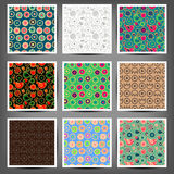 Set seamless patterns of flowers and birds Stock Images