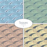 Set of seamless patterns with four seasons Stock Photos