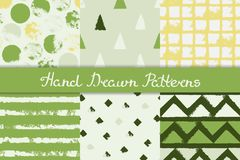 Set of seamless patterns with geometric designs. Circle triangle rhombus stripe in green gray yellow white. Hand drawn. vector illustration