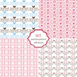 Set of seamless patterns with hearts and butterflies. Pink, blue, brown. Decorative ornament backdrop for fabric stock illustration