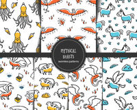 Set of seamless patterns with mythical beasts. Cute childish illustrations. Backgounds with cartoon grifin, dragon, phoenix, unicorn, pegasus, kraken and Royalty Free Stock Image
