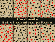Set of seamless patterns with playing cards suits. Numerals cards. Stock Images
