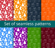 Set of seamless patterns. Symbols of Christmas and winter. Stock Images