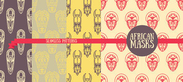 Set of seamless patterns with tribal african masks Stock Photos