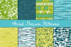 Set of seamless patterns in white, green, blue and yellow. Ink and brush. Hand drawn. Vector illustration Stock Photos