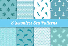 Set of seamless sea patterns. Wave, anchor, dolphin, crab, steer. Ing wheel and sea horse vector textures Stock Image