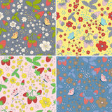 Set of seamless strawberry patterns. Collection of seamless strawberry patterns with hand drawn strawberries, flowers, leaves and butterfly in different colors Stock Images