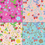 Set of seamless strawberry patterns. Collection of seamless strawberry patterns with hand drawn strawberries, flowers, leaves and butterfly in different colors Royalty Free Stock Image